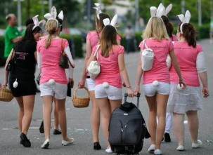 "A group of girls dressed as ""security bunnies"" walk past a soccer stadium as they arrive for a hen's night party in Wolfsburg, May 23, 2009. REUTERS/Kai Pfaffenbach (GERMANY SOCIETY)"